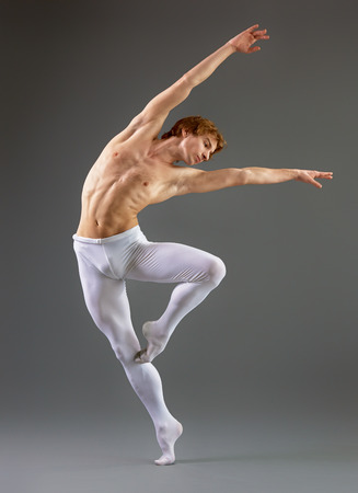 42260304 - modern ballet dancer on grey background
